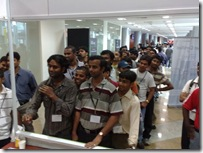 Attendees lining up to play the Community dart game at TechEd India